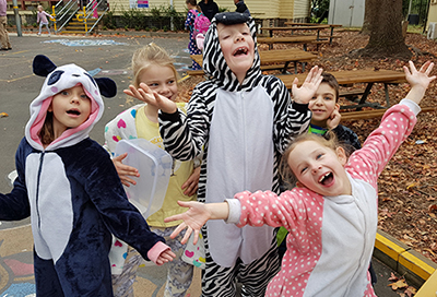 five kids celebrate stay in bed day at school