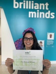 Dr Rocio Rius holds her certificate for Excellence in Mitochondrial Research